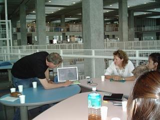 Checking on the day's film production. Professor Hillel Weintraub & TV reporter Judit Kawaguchi.