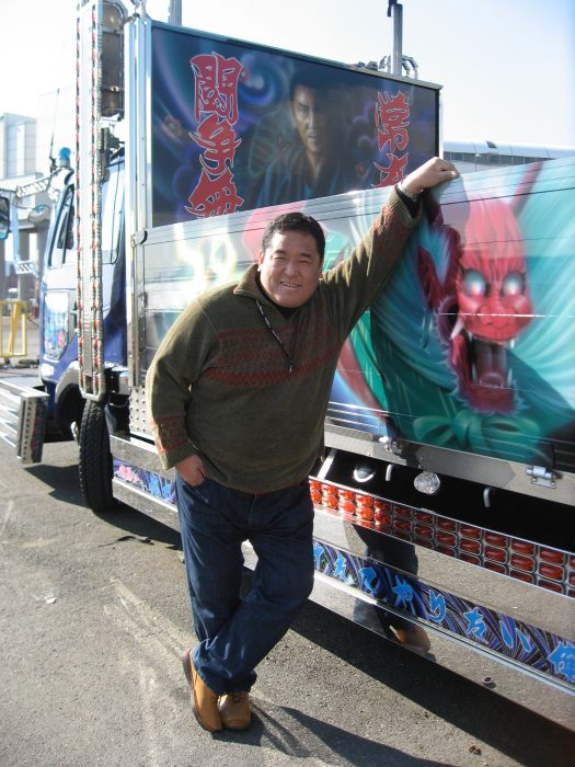 Dekotora movie producer Tamegoro Sudo with one of his favorite dekotora in Tokyo. Photo by Judit Kawaguchi.