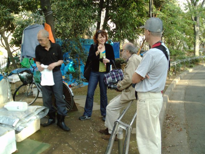 Filmmaker Radovan Tadic w his assistant Judit Kawaguchi interviewing the homeless in Tokyo