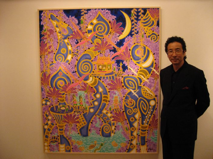 Japanese artist Rei Torii with one of his paintings in Tokyo, August 2006. Photo by Judit Kawaguchi