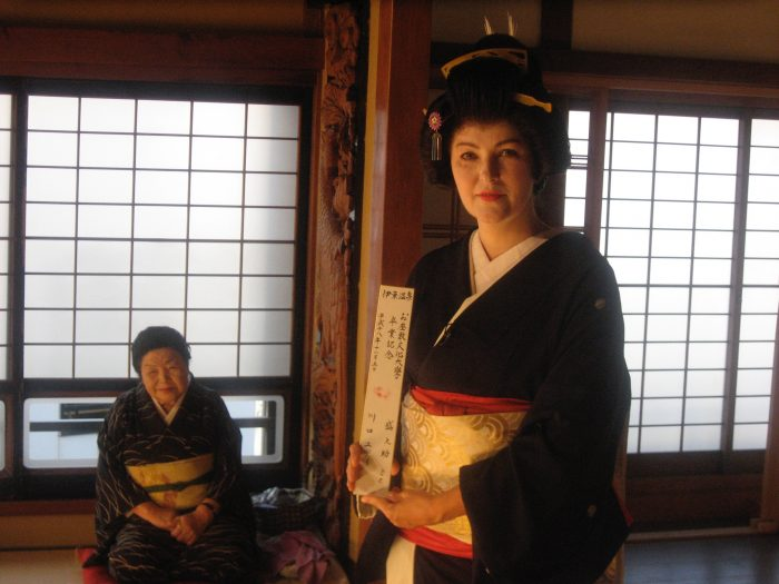 Judit Kawaguchi with her sensei who taught her singing to prepare her for