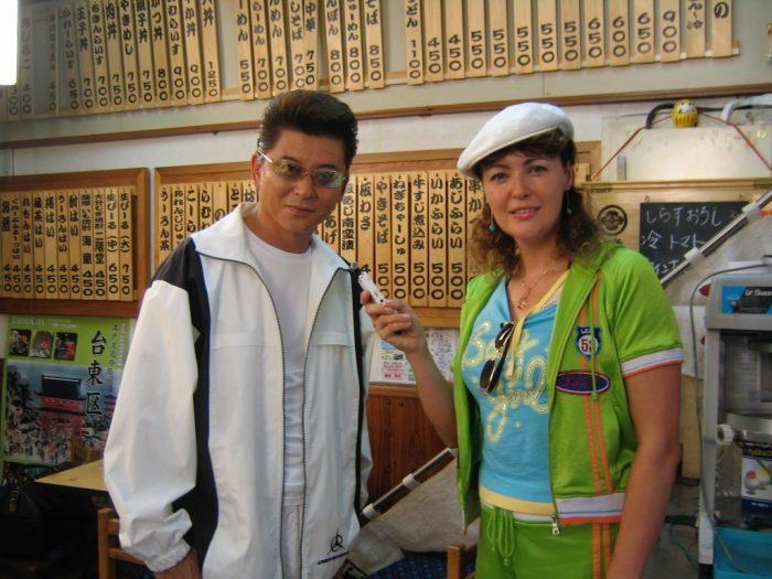 Japanese actor Aikawa Show & journalist Judit Kawaguchi during filming in Asakusa, Tokyo