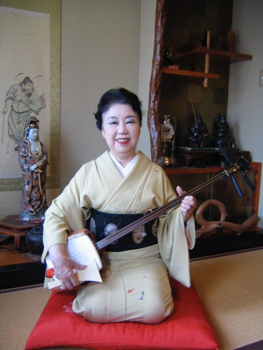 Folk singer, shamisen player Suzue Akashi, photographed by Judit Kawaguchi