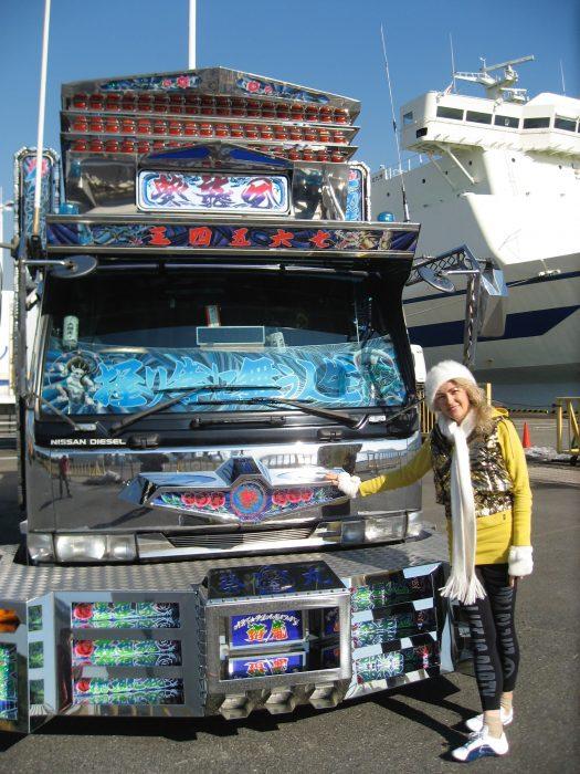 Journalist Judit Kawaguchi with a dekotora in Tokyo